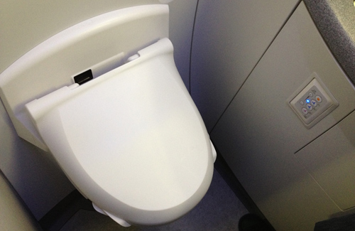 A fancy airplane toilet (complete with bidet) on ANA. (Image: kalleboo)