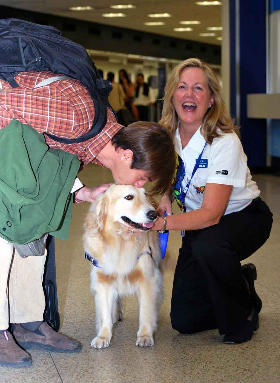 Casey brings cheer to passengers at Miami International Airport. (Image: Miami-Dade Aviation Department)