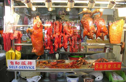 Roasted meats at a hawker stall (Image: Jonas Lamis