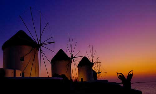 Mykonos windmills at sunset (Image: hassanrafeek used under a Creative Commons Attribution-ShareAlike license)