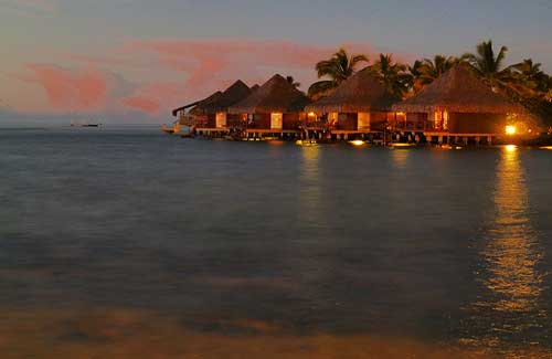 Tahitian huts on the water (Image: Michael R Perry)