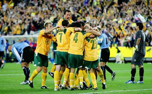 The Australian soccer team celebrates at a World Cup qualifying game in 2005 (Image: english_family)