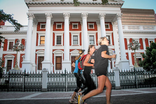 Cruising past parliament buildings, Cape Town. Photo by Run Cape Town