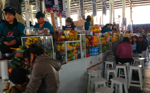 The long line of juice stands at San Pedro market in Cusco (Image: Melisse Hinkle)