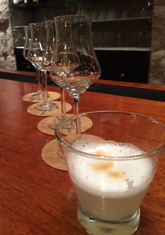 A pisco tasting: Four different types of pisco topped off by a Peruvian classic: a pisco sour (Image: Melisse Hinkle)