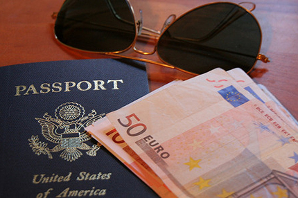 US passport and euro currency notes