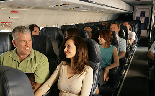 man and woman couple sitting on a plane
