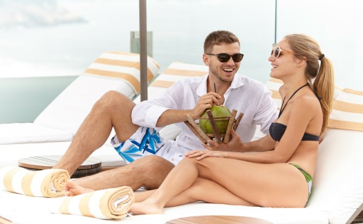Couple sips coconut at resort