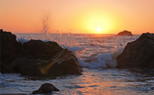 Lisa Williams, Waves Splashing at Sunset via Flickr CC BY 2.0