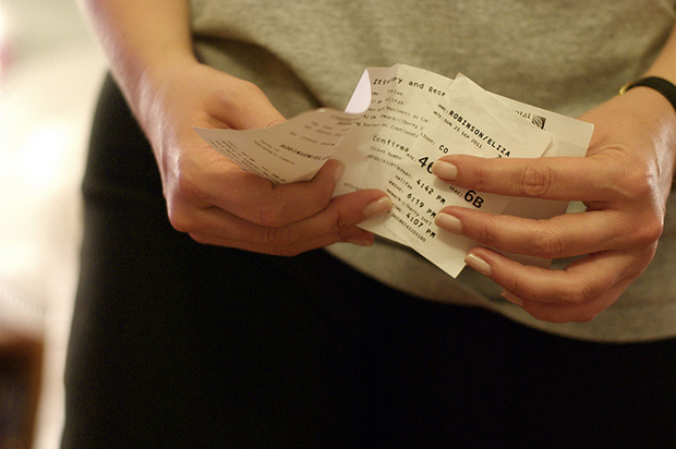 close-up of someone holding boarding passes