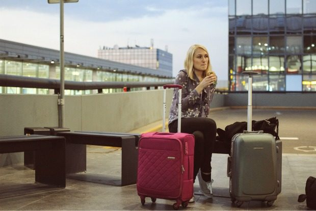 Traveler outside of airport with luggage