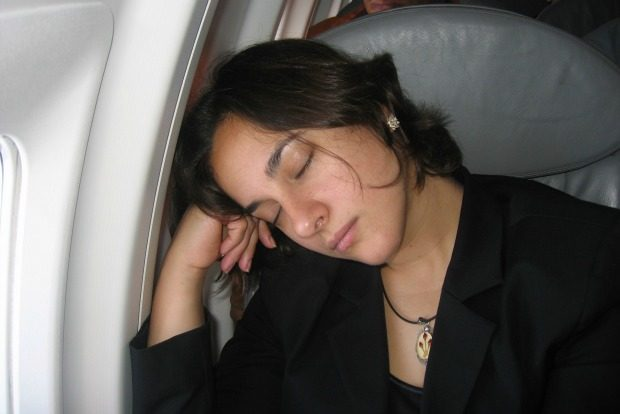 passenger sleeping on plane