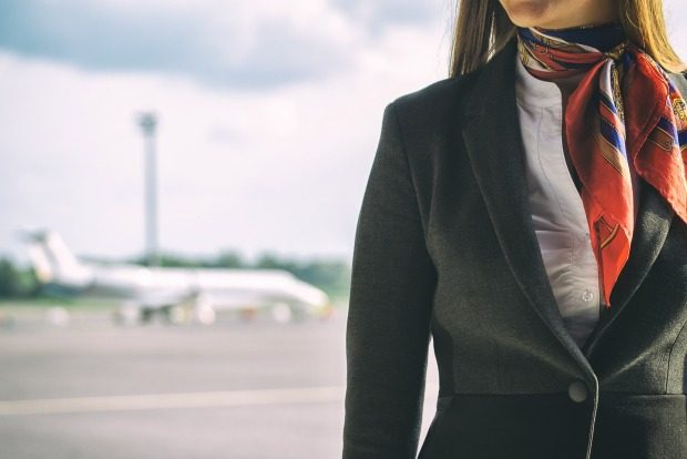 flight attendant on tarmac