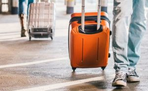 carry-on being wheeled in an airport