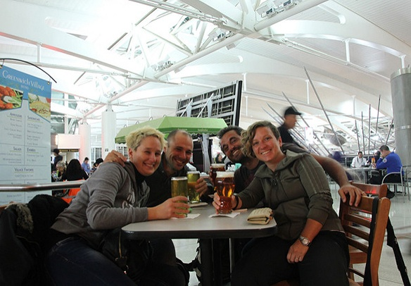 group of people drinking at an airport bar