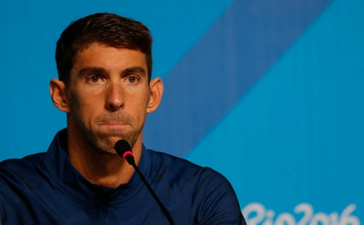 11 things you experience at your boarding gate, as explained by Phelps Faces 2