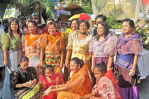 Women in traditional costume.. Photo by Obando Fertility Rites