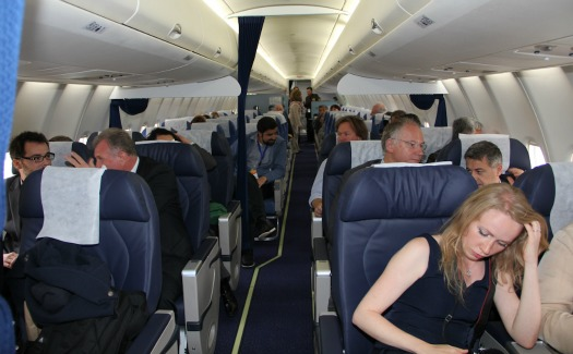passengers in airplane cabin