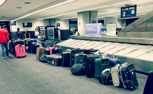 "Kenneth Lu, ""Please report any unattended luggage."" via Flickr CC BY 2.0"