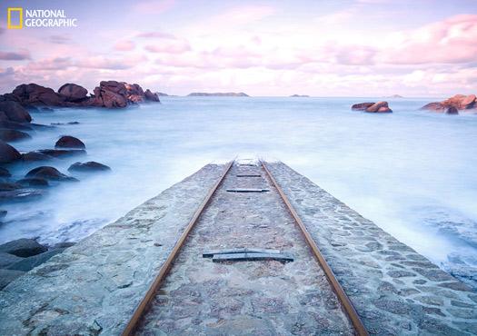 Le long du sentier des douaniers, entre Perros et Tregastel, en pleines côtes d'armor, la marée se confronte au granit rose de la baie. Photo and caption by Thomas DORLEANS, National Geographic 2014 Photo Contest