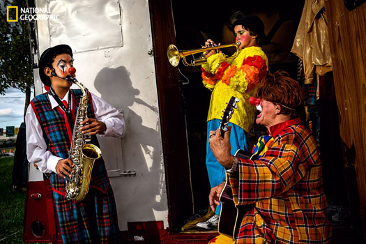 Clown and his two grandkids have a jam out session by their trailer in between circus acts. Photo and caption by Daniel Kudish, National Geographic 2014 Photo Contest