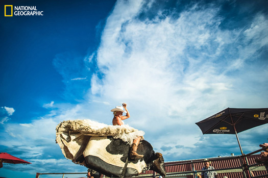"""""""The country girl finds something special to do for her wedding at the world famous Big Valley Jamboree.""""  Photo and caption by Carey Nash, National Geographic 2014 Photo Contest"""