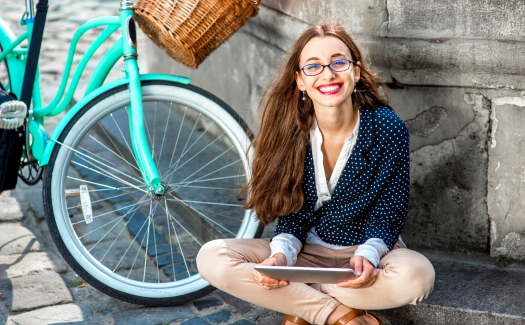Businesswoman going to work by bicycle (iStock/RossHelen)