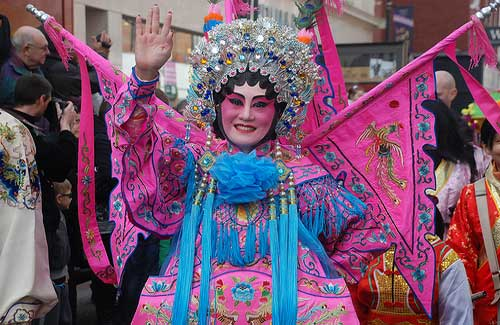 A woman in costume during a Chinese New Year celebration (Image: mariasoleil2011)