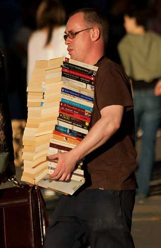 There's no need to lug your book collection along on vacation (Image: garryknight used under a Creative Commons Attribution-ShareAlike license)