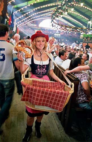 Woman selling pretzels at Oktoberfest (Image: constant progression)