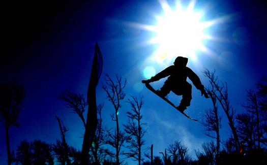 A snowboarder catches some air. (Image: pincusvt)