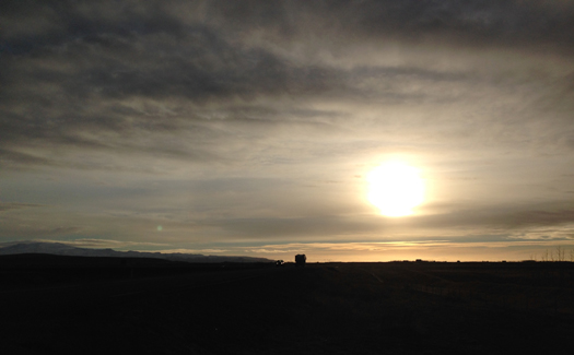 The sun rises in Hella, Iceland.