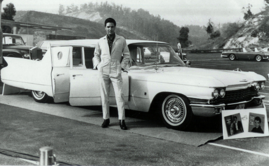 Elvis in front of his custom 1960 Cadillac Limousine (Image: that_chrysler_guy used under a Creative Commons Attribution-ShareAlike license)