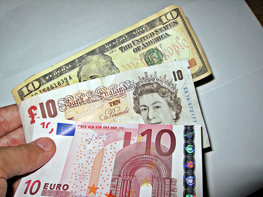 Pounds to dollars and euros. Photo: aImages Money
